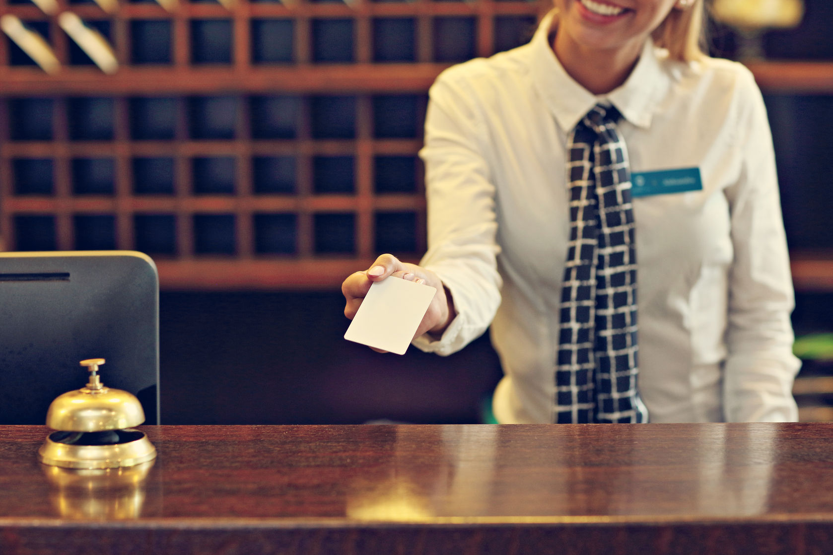 64761984 - picture of receptionist giving key card